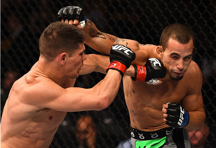 BOSTON, MA - JANUARY 18:  (R-L) Sean Soriano punches Charles Rosa in their featherweight fight during the UFC Fight Night event at the TD Garden on January 18, 2015 in Boston, Massachusetts. (Photo by Jeff Bottari/Zuffa LLC/Zuffa LLC via Getty Images)