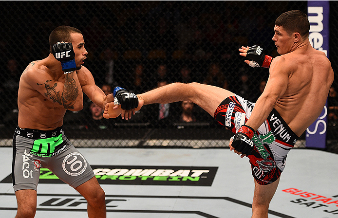 BOSTON, MA - JANUARY 18:  (R-L) Charles Rosa kicks Sean Soriano in their featherweight fight during the UFC Fight Night event at the TD Garden on January 18, 2015 in Boston, Massachusetts. (Photo by Jeff Bottari/Zuffa LLC/Zuffa LLC via Getty Images)