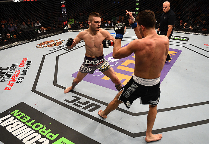 BOSTON, MA - JANUARY 18:  Johnny Case punches Frankie Perez in their lightweight fight during the UFC Fight Night event at the TD Garden on January 18, 2015 in Boston, Massachusetts. (Photo by Jeff Bottari/Zuffa LLC/Zuffa LLC via Getty Images)