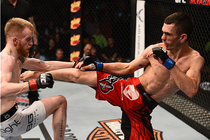 BOSTON, MA - JANUARY 18:  (R-L) Shane Howell kicks Paddy Holohan in their flyweight fight during the UFC Fight Night event at the TD Garden on January 18, 2015 in Boston, Massachusetts. (Photo by Jeff Bottari/Zuffa LLC/Zuffa LLC via Getty Images)