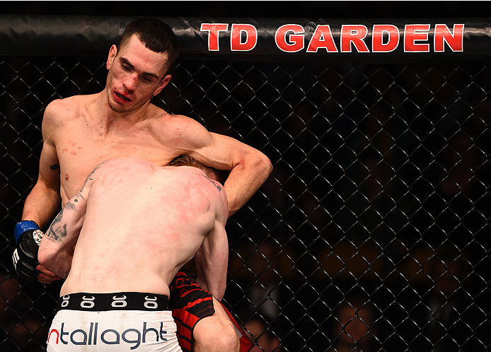 BOSTON, MA - JANUARY 18:  Paddy Holohan tackles Shane Howell in their flyweight fight during the UFC Fight Night event at the TD Garden on January 18, 2015 in Boston, Massachusetts. (Photo by Jeff Bottari/Zuffa LLC/Zuffa LLC via Getty Images)