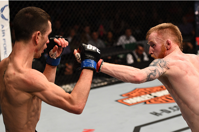 BOSTON, MA - JANUARY 18:  (R-L) Paddy Holohan punches Shane Howell in their flyweight fight during the UFC Fight Night event at the TD Garden on January 18, 2015 in Boston, Massachusetts. (Photo by Jeff Bottari/Zuffa LLC/Zuffa LLC via Getty Images)