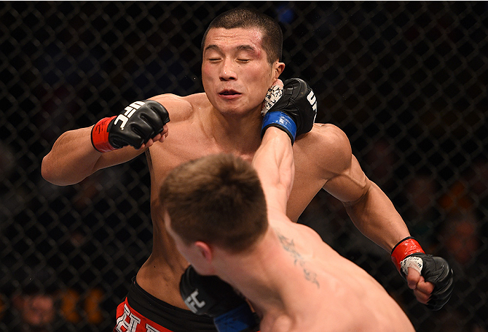BOSTON, MA - JANUARY 18:  Chris Wade punches Zhang Lipeng in their lightweight fight during the UFC Fight Night event at the TD Garden on January 18, 2015 in Boston, Massachusetts. (Photo by Jeff Bottari/Zuffa LLC/Zuffa LLC via Getty Images)