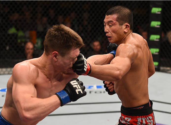 BOSTON, MA - JANUARY 18:  (R-L) Zhang Lipeng punches Chris Wade in their lightweight fight during the UFC Fight Night event at the TD Garden on January 18, 2015 in Boston, Massachusetts. (Photo by Jeff Bottari/Zuffa LLC/Zuffa LLC via Getty Images)