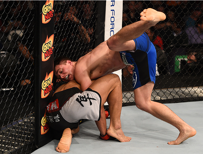BOSTON, MA - JANUARY 18:  (R-L) Chris Wade tackles Zhang Lipeng in their lightweight fight during the UFC Fight Night event at the TD Garden on January 18, 2015 in Boston, Massachusetts. (Photo by Jeff Bottari/Zuffa LLC/Zuffa LLC via Getty Images)