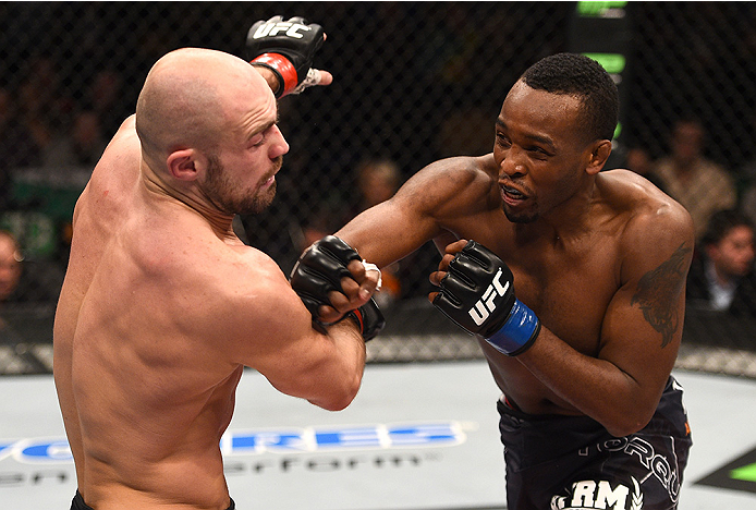 BOSTON, MA - JANUARY 18: (R-L) Sean Spencer punches Cathal Pendred in their welterweight fight during the UFC Fight Night event at the TD Garden on January 18, 2015 in Boston, Massachusetts. (Photo by Jeff Bottari/Zuffa LLC/Zuffa LLC via Getty Images)