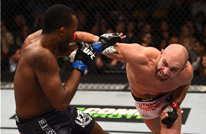 BOSTON, MA - JANUARY 18: (R-L) Cathal Pendred punches Sean Spencer in their welterweight fight during the UFC Fight Night event at the TD Garden on January 18, 2015 in Boston, Massachusetts. (Photo by Jeff Bottari/Zuffa LLC/Zuffa LLC via Getty Images)