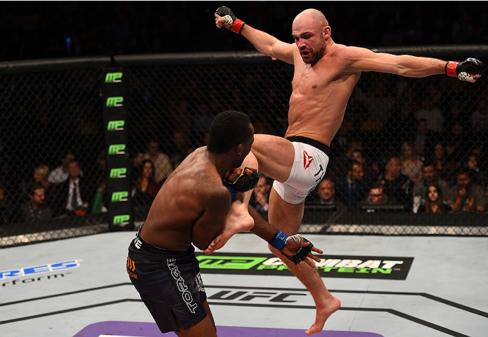 BOSTON, MA - JANUARY 18: (R-L) Cathal Pendred kicks Sean Spencer in their welterweight fight during the UFC Fight Night event at the TD Garden on January 18, 2015 in Boston, Massachusetts. (Photo by Jeff Bottari/Zuffa LLC/Zuffa LLC via Getty Images)