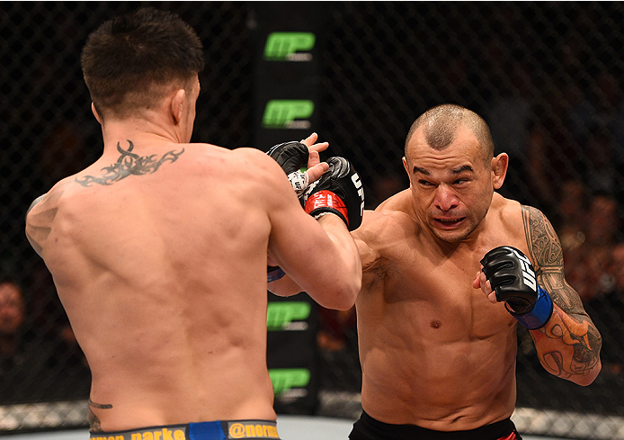 BOSTON, MA - JANUARY 18:  (R-L) Gleison Tibau punches Norman Parke in their lightweight fight during the UFC Fight Night event at the TD Garden on January 18, 2015 in Boston, Massachusetts. (Photo by Jeff Bottari/Zuffa LLC/Zuffa LLC via Getty Images)