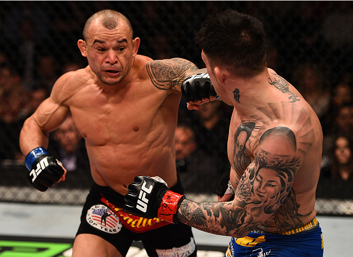 BOSTON, MA - JANUARY 18:  (L-R) Gleison Tibau punches Norman Parke in their lightweight fight during the UFC Fight Night event at the TD Garden on January 18, 2015 in Boston, Massachusetts. (Photo by Jeff Bottari/Zuffa LLC/Zuffa LLC via Getty Images)