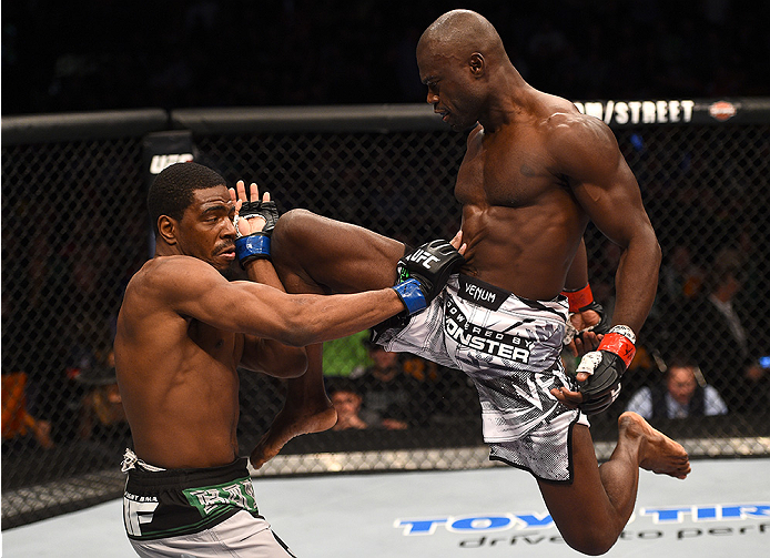 BOSTON, MA - JANUARY 18:  (R-L) Uriah Hall knees Ron Stallings in their middleweight fight during the UFC Fight Night event at the TD Garden on January 18, 2015 in Boston, Massachusetts. (Photo by Jeff Bottari/Zuffa LLC/Zuffa LLC via Getty Images)