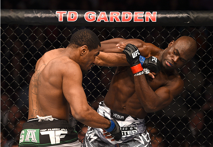 BOSTON, MA - JANUARY 18:  (L-R) Ron Stallings punches Uriah Hall in their middleweight fight during the UFC Fight Night event at the TD Garden on January 18, 2015 in Boston, Massachusetts. (Photo by Jeff Bottari/Zuffa LLC/Zuffa LLC via Getty Images)