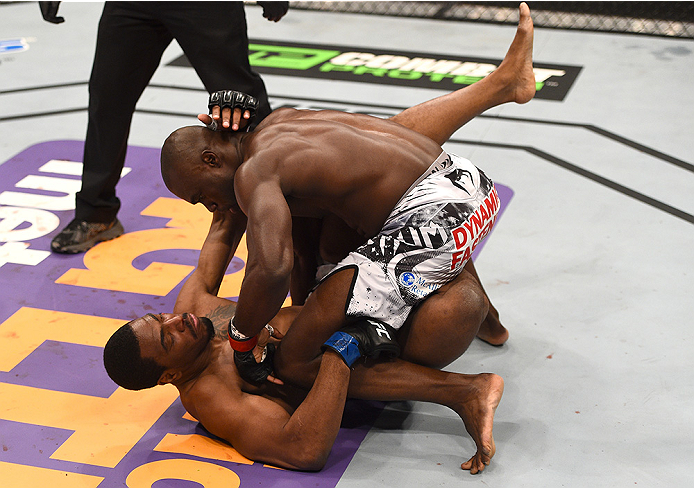 BOSTON, MA - JANUARY 18:  Uriah Hall punches Ron Stallings in their middleweight fight during the UFC Fight Night event at the TD Garden on January 18, 2015 in Boston, Massachusetts. (Photo by Jeff Bottari/Zuffa LLC/Zuffa LLC via Getty Images)