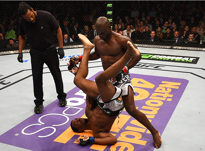 BOSTON, MA - JANUARY 18:  Uriah Hall tackles Ron Stallings in their middleweight fight during the UFC Fight Night event at the TD Garden on January 18, 2015 in Boston, Massachusetts. (Photo by Jeff Bottari/Zuffa LLC/Zuffa LLC via Getty Images)
