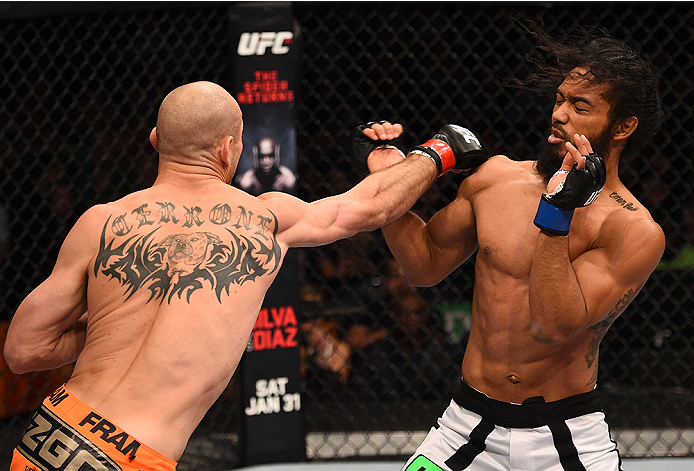 BOSTON, MA - JANUARY 18:  (L-R) Donald Cerrone punches Benson Henderson in their lightweight fight during the UFC Fight Night event at the TD Garden on January 18, 2015 in Boston, Massachusetts. (Photo by Jeff Bottari/Zuffa LLC/Zuffa LLC via Getty Images)