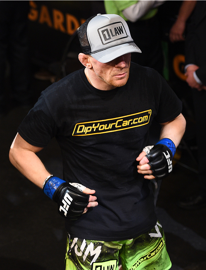 BOSTON, MA - JANUARY 18:  Dennis Siver of Germany enters the arena before a featherweight fight against Conor McGregor of Ireland during the UFC Fight Night event at the TD Garden on January 18, 2015 in Boston, Massachusetts. (Photo by Jeff Bottari/Zuffa