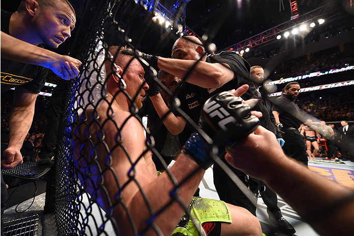 BOSTON, MA - JANUARY 18:  Dennis Siver of Germany receives treatment during a featherweight fight against Conor McGregor of Ireland during the UFC Fight Night event at the TD Garden on January 18, 2015 in Boston, Massachusetts. (Photo by Jeff Bottari/Zuff