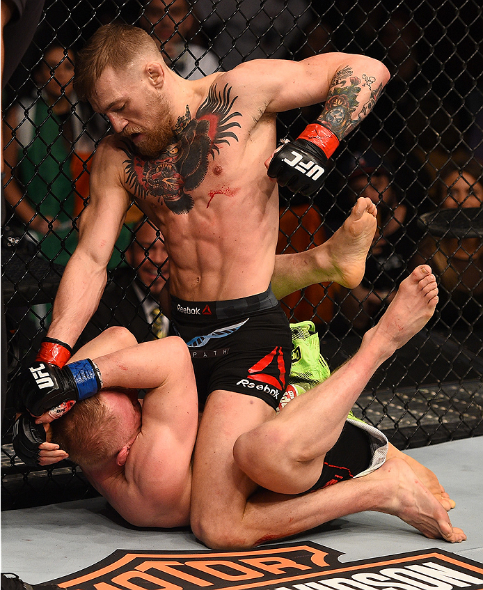 BOSTON, MA - JANUARY 18:  Conor McGregor of Ireland punches Dennis Siver of Germany in their featherweight fight during the UFC Fight Night event at the TD Garden on January 18, 2015 in Boston, Massachusetts. (Photo by Jeff Bottari/Zuffa LLC/Zuffa LLC via