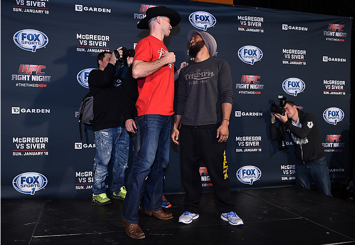 BOSTON, MA - JANUARY 16:  (L-R) UFC lightweights Donald 'Cowboy' Cerrone and Benson 'Smooth' Henderson face off for the media at Faneuil Hall on January 16, 2015 in Boston, Massachusetts. (Photo by Jeff Bottari/Zuffa LLC/Zuffa LLC via Getty Images)