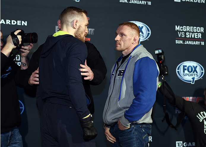 BOSTON, MA - JANUARY 16:  UFC featherweights Conor McGregor of Ireland (L) and Dennis Siver of Germany face off for the media at Faneuil Hall on January 16, 2015 in Boston, Massachusetts. (Photo by Jeff Bottari/Zuffa LLC/Zuffa LLC via Getty Images)