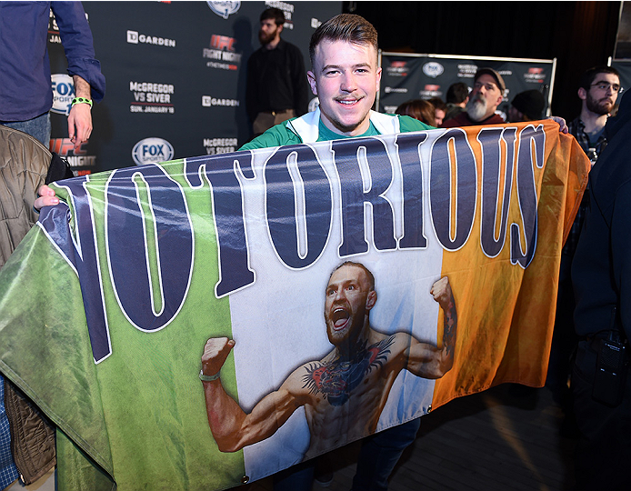BOSTON, MA - JANUARY 16:  A fan poses with his Conor McGregor Irish flag at Faneuil Hall on January 16, 2015 in Boston, Massachusetts. (Photo by Jeff Bottari/Zuffa LLC/Zuffa LLC via Getty Images)