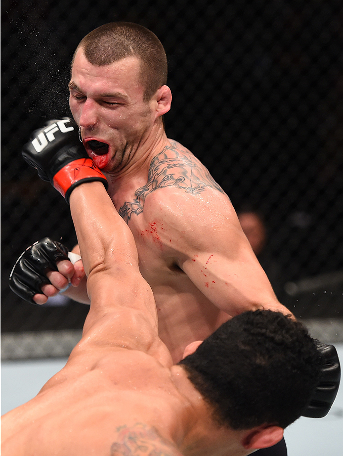 BOSTON, MA - JANUARY 17:  (R-L) Francimar Barroso of Brazil punches Elvis Mutapcic of Bosnia in their light heavyweight bout during the UFC Fight Night event inside TD Garden on January 17, 2016 in Boston, Massachusetts. (Photo by Jeff Bottari/Zuffa LLC/Z