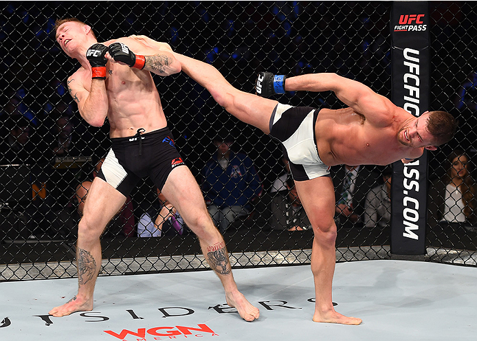 BOSTON, MA - JANUARY 17:  (R-L) Daron Cruickshank kicks Paul Felder in their lightweight bout during the UFC Fight Night event inside TD Garden on January 17, 2016 in Boston, Massachusetts. (Photo by Jeff Bottari/Zuffa LLC/Zuffa LLC via Getty Images)