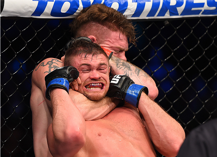 BOSTON, MA - JANUARY 17:  (R-L) Paul Felder secures a rear choke submission against Daron Cruickshank in their lightweight bout during the UFC Fight Night event inside TD Garden on January 17, 2016 in Boston, Massachusetts. (Photo by Jeff Bottari/Zuffa LL