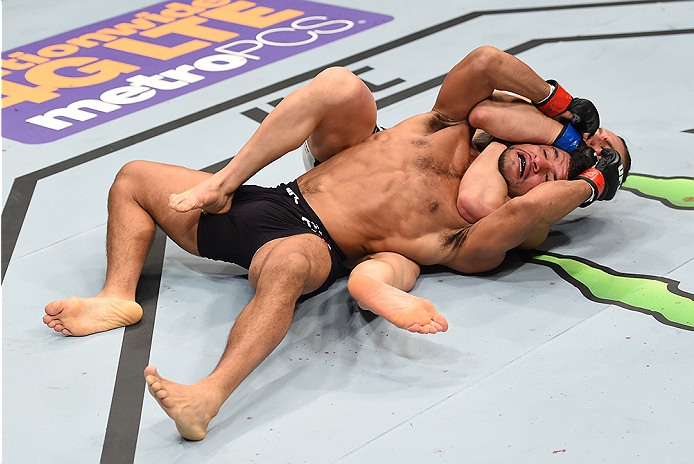 BOSTON, MA - JANUARY 17:  (L-R) Luke Sanders secures a rear choke submission against Maximo Blanco in their featherweight bout during the UFC Fight Night event inside TD Garden on January 17, 2016 in Boston, Massachusetts. (Photo by Jeff Bottari/Zuffa LLC