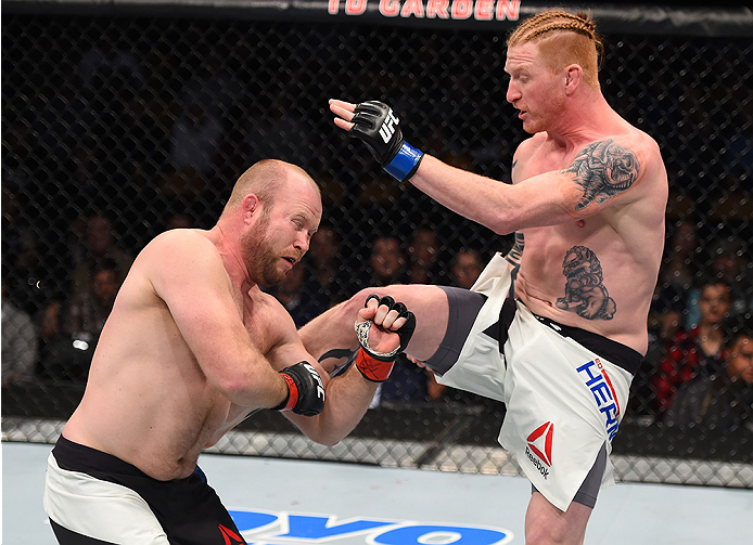 BOSTON, MA - JANUARY 17:  (R-L) Ed Herman kicks Tim Boetsch in their light heavyweight bout during the UFC Fight Night event inside TD Garden on January 17, 2016 in Boston, Massachusetts. (Photo by Jeff Bottari/Zuffa LLC/Zuffa LLC via Getty Images)