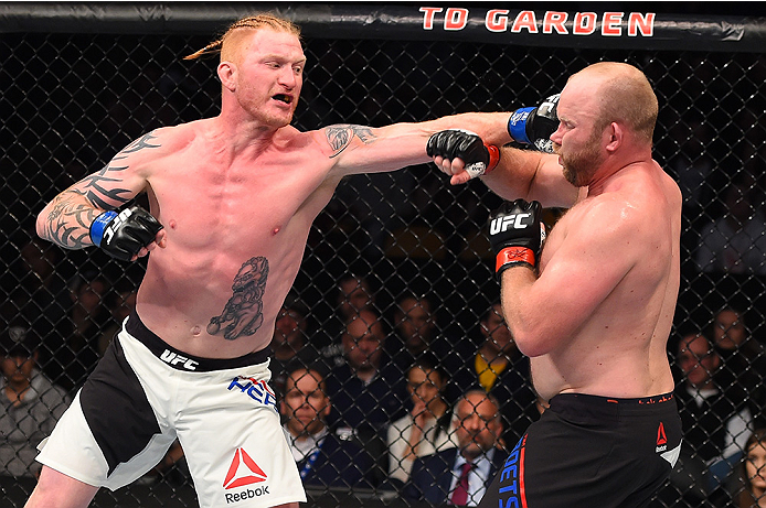 BOSTON, MA - JANUARY 17:  (L-R) Ed Herman punches Tim Boetsch in their light heavyweight bout during the UFC Fight Night event inside TD Garden on January 17, 2016 in Boston, Massachusetts. (Photo by Jeff Bottari/Zuffa LLC/Zuffa LLC via Getty Images)