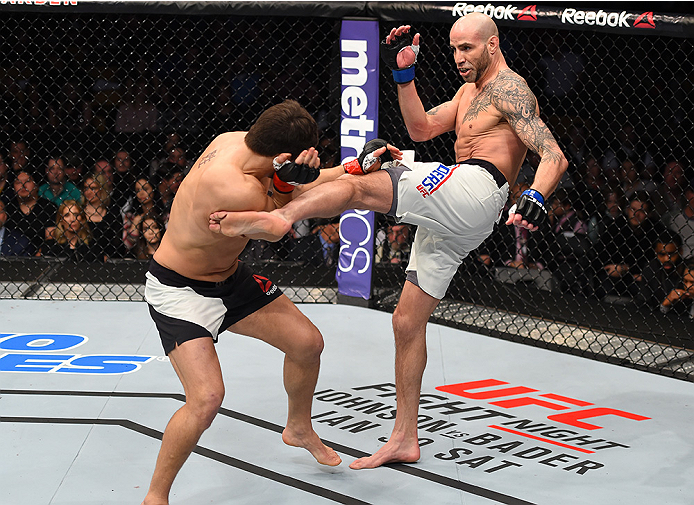 BOSTON, MA - JANUARY 17:  (R-L) Ben Saunders kicks Patrick Cote of Canada in their welterweight bout during the UFC Fight Night event inside TD Garden on January 17, 2016 in Boston, Massachusetts. (Photo by Jeff Bottari/Zuffa LLC/Zuffa LLC via Getty Image