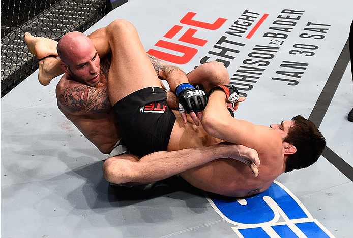 BOSTON, MA - JANUARY 17:  (R-L) Patrick Cote of Canada attempts to secure an arm bar submission against Ben Saunders in their welterweight bout during the UFC Fight Night event inside TD Garden on January 17, 2016 in Boston, Massachusetts. (Photo by Jeff