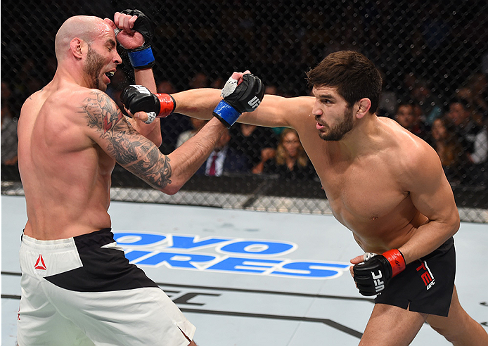 BOSTON, MA - JANUARY 17:  (R-L) Patrick Cote of Canada punches Ben Saunders in their welterweight bout during the UFC Fight Night event inside TD Garden on January 17, 2016 in Boston, Massachusetts. (Photo by Jeff Bottari/Zuffa LLC/Zuffa LLC via Getty Ima