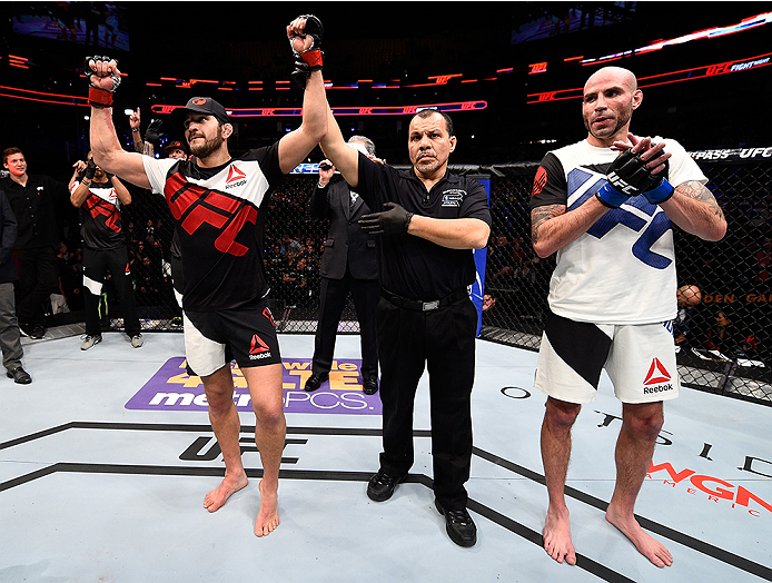BOSTON, MA - JANUARY 17:  Patrick Cote (L) of Canada celebrates after his TKO victory over Ben Saunders in their welterweight bout during the UFC Fight Night event inside TD Garden on January 17, 2016 in Boston, Massachusetts. (Photo by Jeff Bottari/Zuffa