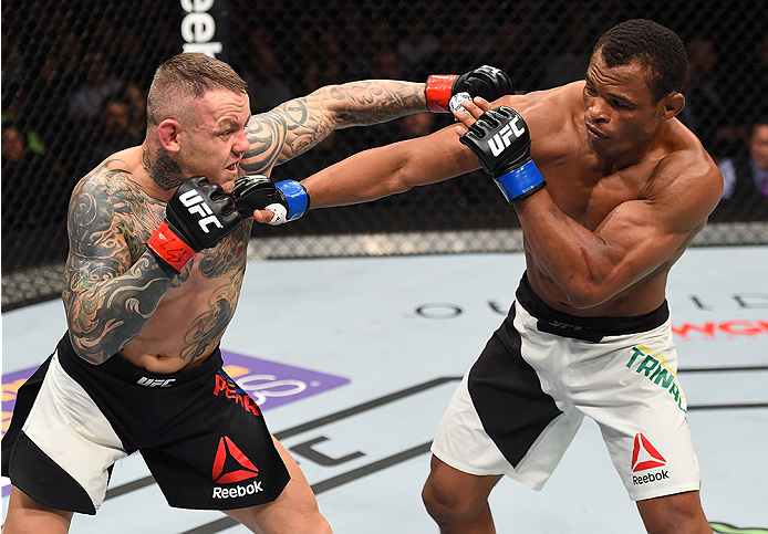 BOSTON, MA - JANUARY 17:  (L-R) Ross Pearson of England punches Francisco Trinaldo of Brazil in their lightweight bout during the UFC Fight Night event inside TD Garden on January 17, 2016 in Boston, Massachusetts. (Photo by Jeff Bottari/Zuffa LLC/Zuffa L