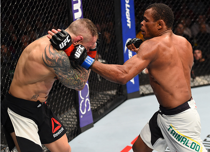 BOSTON, MA - JANUARY 17:  (R-L) Francisco Trinaldo of Brazil punches Ross Pearson of England in their lightweight bout during the UFC Fight Night event inside TD Garden on January 17, 2016 in Boston, Massachusetts. (Photo by Jeff Bottari/Zuffa LLC/Zuffa L