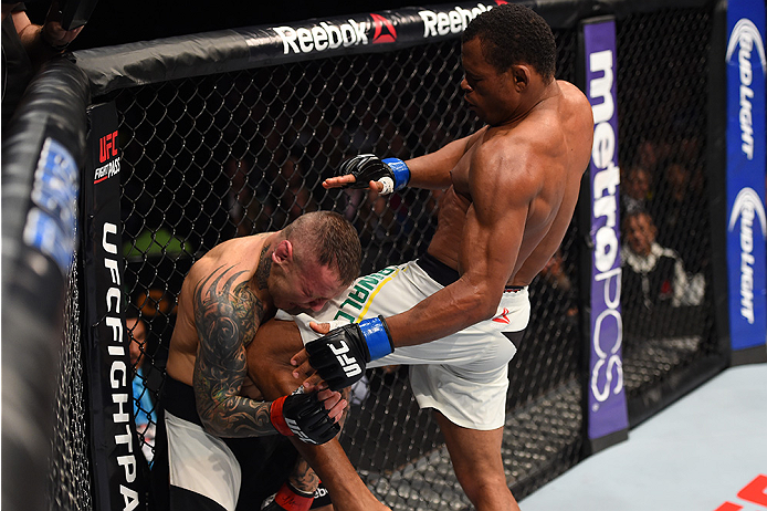 BOSTON, MA - JANUARY 17:  (R-L) Francisco Trinaldo of Brazil knees Ross Pearson of England in their lightweight bout during the UFC Fight Night event inside TD Garden on January 17, 2016 in Boston, Massachusetts. (Photo by Jeff Bottari/Zuffa LLC/Zuffa LLC