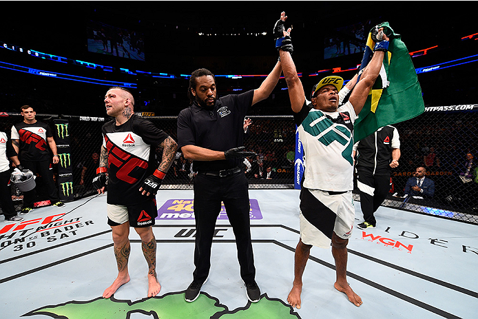 BOSTON, MA - JANUARY 17:  Francisco Trinaldo (R) of Brazil celebrates after his victory over Ross Pearson of England in their lightweight bout during the UFC Fight Night event inside TD Garden on January 17, 2016 in Boston, Massachusetts. (Photo by Jeff B