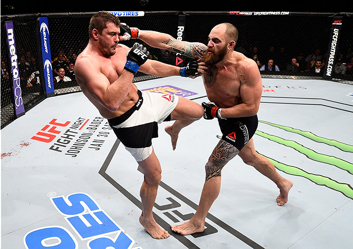 BOSTON, MA - JANUARY 17:  (R-L) Travis Browne punches Matt Mitrione in their heavyweight bout during the UFC Fight Night event inside TD Garden on January 17, 2016 in Boston, Massachusetts. (Photo by Jeff Bottari/Zuffa LLC/Zuffa LLC via Getty Images)