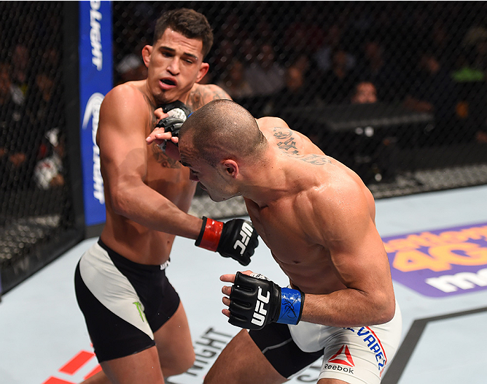 BOSTON, MA - JANUARY 17:  (R-L) Eddie Alvarez punches Anthony Pettis in their lightweight bout during the UFC Fight Night event inside TD Garden on January 17, 2016 in Boston, Massachusetts. (Photo by Jeff Bottari/Zuffa LLC/Zuffa LLC via Getty Images)