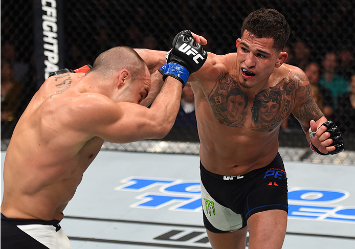 BOSTON, MA - JANUARY 17:  (R-L) Anthony Pettis punches Eddie Alvarez in their lightweight bout during the UFC Fight Night event inside TD Garden on January 17, 2016 in Boston, Massachusetts. (Photo by Jeff Bottari/Zuffa LLC/Zuffa LLC via Getty Images)