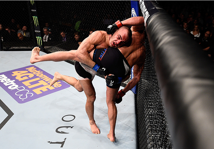 BOSTON, MA - JANUARY 17:  (L-R) Eddie Alvarez takes down Anthony Pettis in their lightweight bout during the UFC Fight Night event inside TD Garden on January 17, 2016 in Boston, Massachusetts. (Photo by Jeff Bottari/Zuffa LLC/Zuffa LLC via Getty Images)