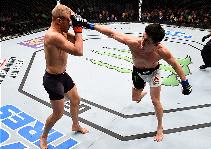 BOSTON, MA - JANUARY 17:  (R-L) Dominick Cruz punches TJ Dillashaw in their UFC bantamweight championship bout during the UFC Fight Night event inside TD Garden on January 17, 2016 in Boston, Massachusetts. (Photo by Jeff Bottari/Zuffa LLC/Zuffa LLC via G