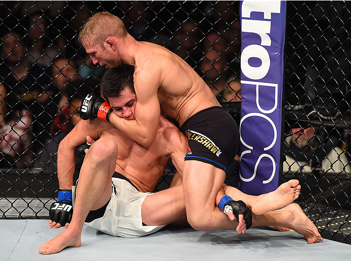 BOSTON, MA - JANUARY 17:  (R-L) TJ Dillashaw grapples with Dominick Cruz in their UFC bantamweight championship bout during the UFC Fight Night event inside TD Garden on January 17, 2016 in Boston, Massachusetts. (Photo by Jeff Bottari/Zuffa LLC/Zuffa LLC