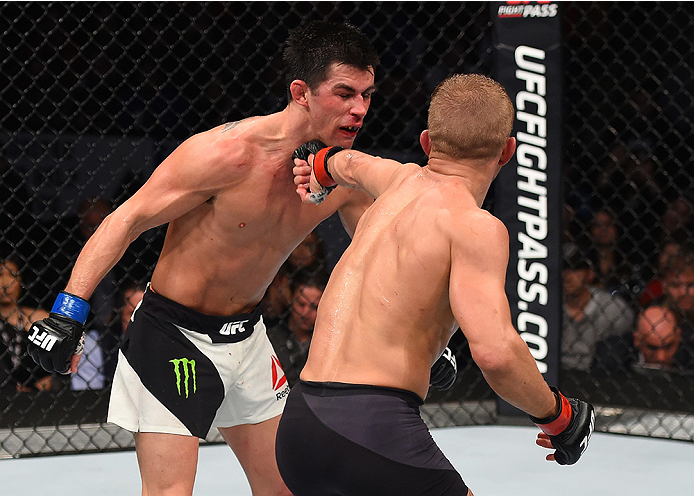BOSTON, MA - JANUARY 17:  (R-L) TJ Dillashaw punches Dominick Cruz in their UFC bantamweight championship bout during the UFC Fight Night event inside TD Garden on January 17, 2016 in Boston, Massachusetts. (Photo by Jeff Bottari/Zuffa LLC/Zuffa LLC via G