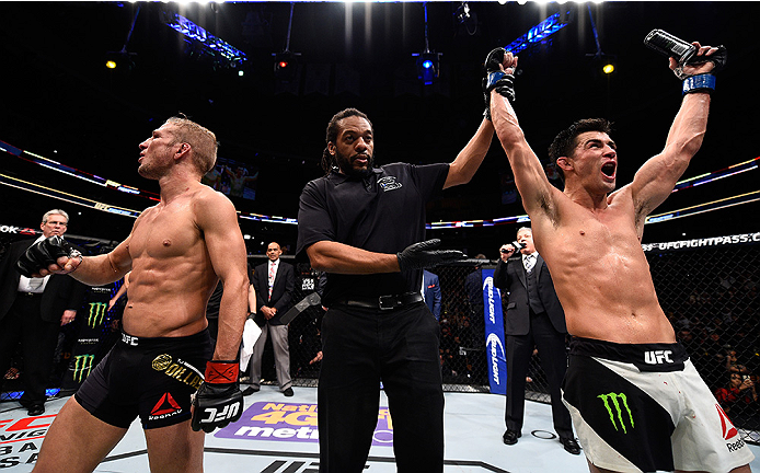 BOSTON, MA - JANUARY 17:  Dominick Cruz (R) celebrates his split-decision victory over TJ Dillashaw (L) in their UFC bantamweight championship bout during the UFC Fight Night event inside TD Garden on January 17, 2016 in Boston, Massachusetts. (Photo by J