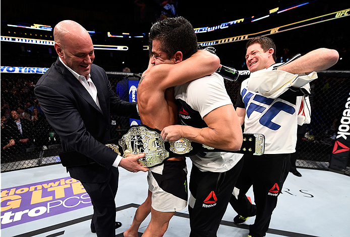 BOSTON, MA - JANUARY 17:  Dominick Cruz celebrates his split-decision victory over TJ Dillashaw in their UFC bantamweight championship bout during the UFC Fight Night event inside TD Garden on January 17, 2016 in Boston, Massachusetts. (Photo by Jeff Bott