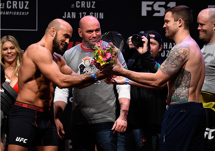 BOSTON, MA - JANUARY 16:  (R-L) Sean OConnell presents a bouquet to opponent Ilir Latifi of Sweden during the UFC weigh-in at the Wang Theatre on January 16, 2016 in Boston, Massachusetts. (Photo by Jeff Bottari/Zuffa LLC/Zuffa LLC via Getty Images)