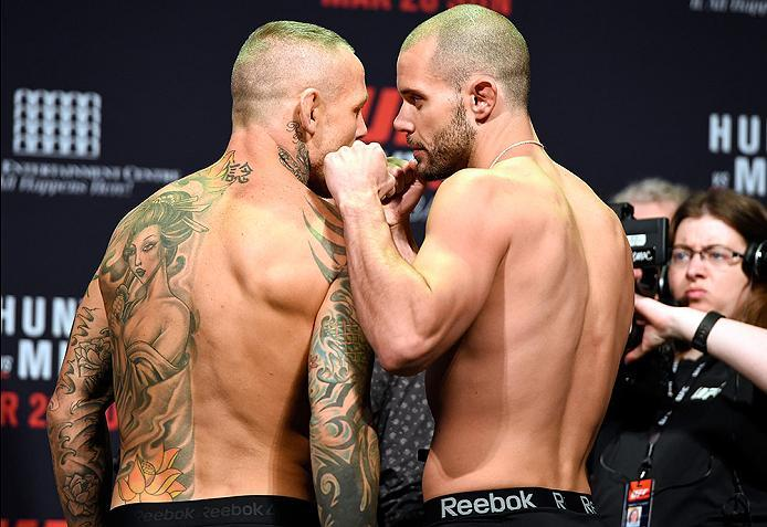 BRISBANE, AUSTRALIA - MARCH 19:  (L-R) Opponents Ross Pearson of England and Chad Laprise of Canada face off during the UFC Fight Night weigh-in at the Brisbane Entertainment Centre on March 19, 2016 in Brisbane, Australia. (Photo by Josh Hedges/Zuffa LLC